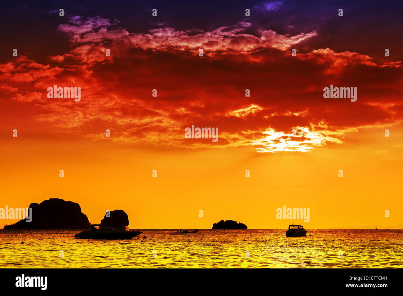 Intense colors sunset over sea, nature background. - Stock Image