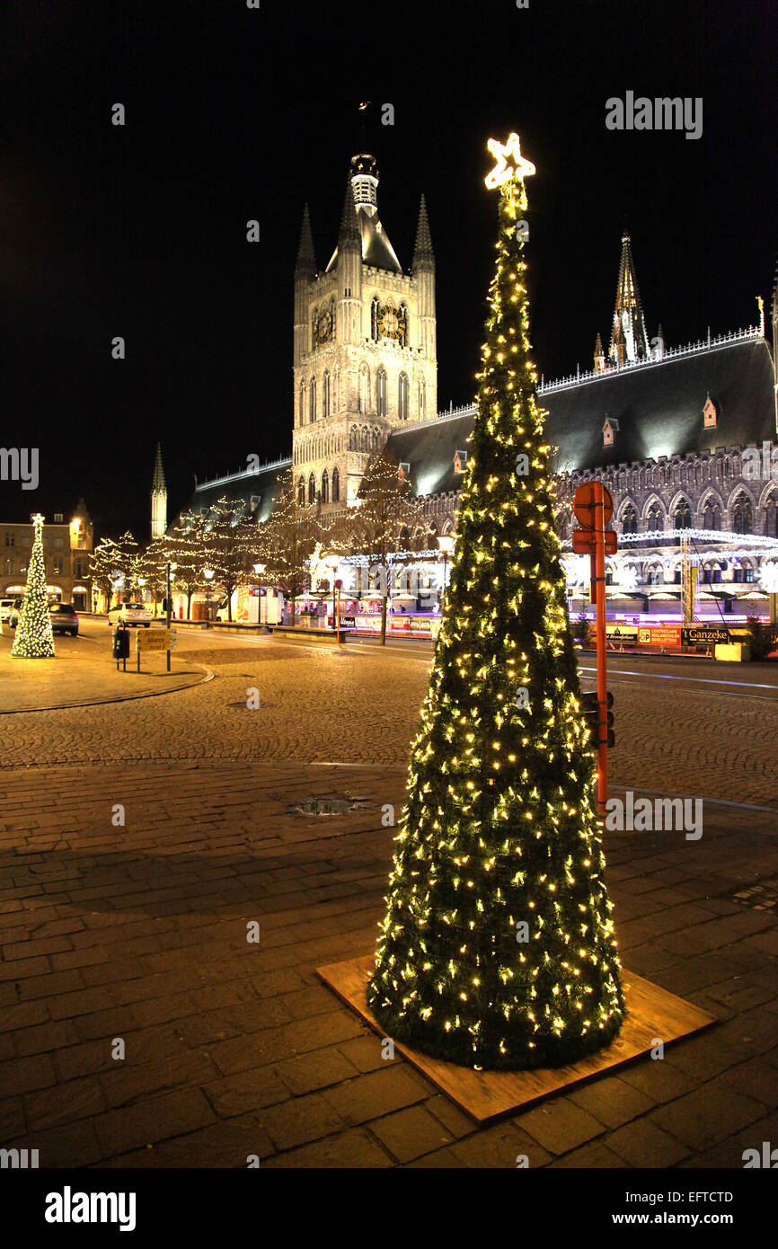 Ypres Christmas.Belgium.The Xmas market is held in the Grote Markt - the main square. Stock Photo