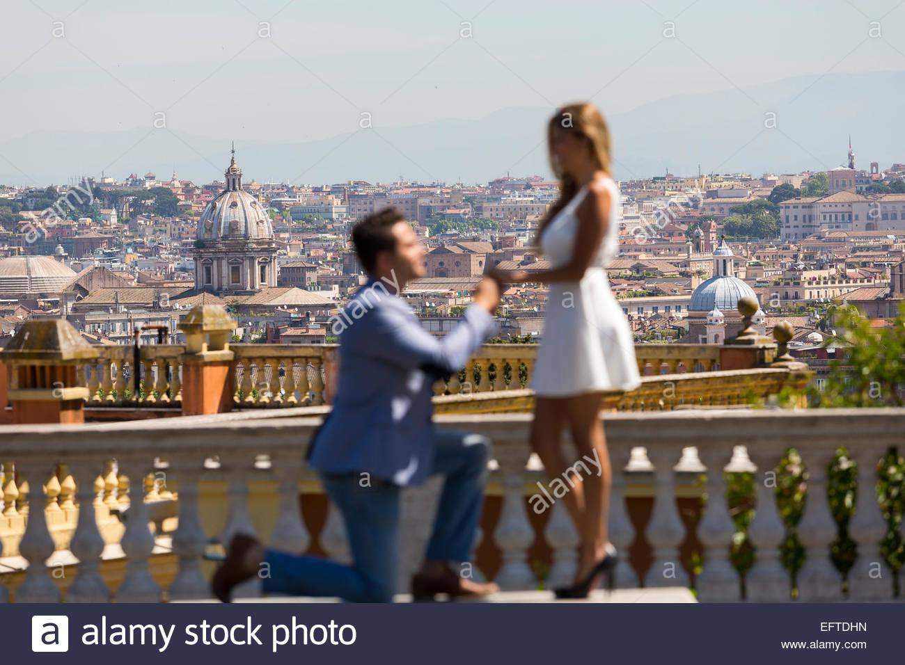 Wedding proposal over the roman rooftops - Stock Image
