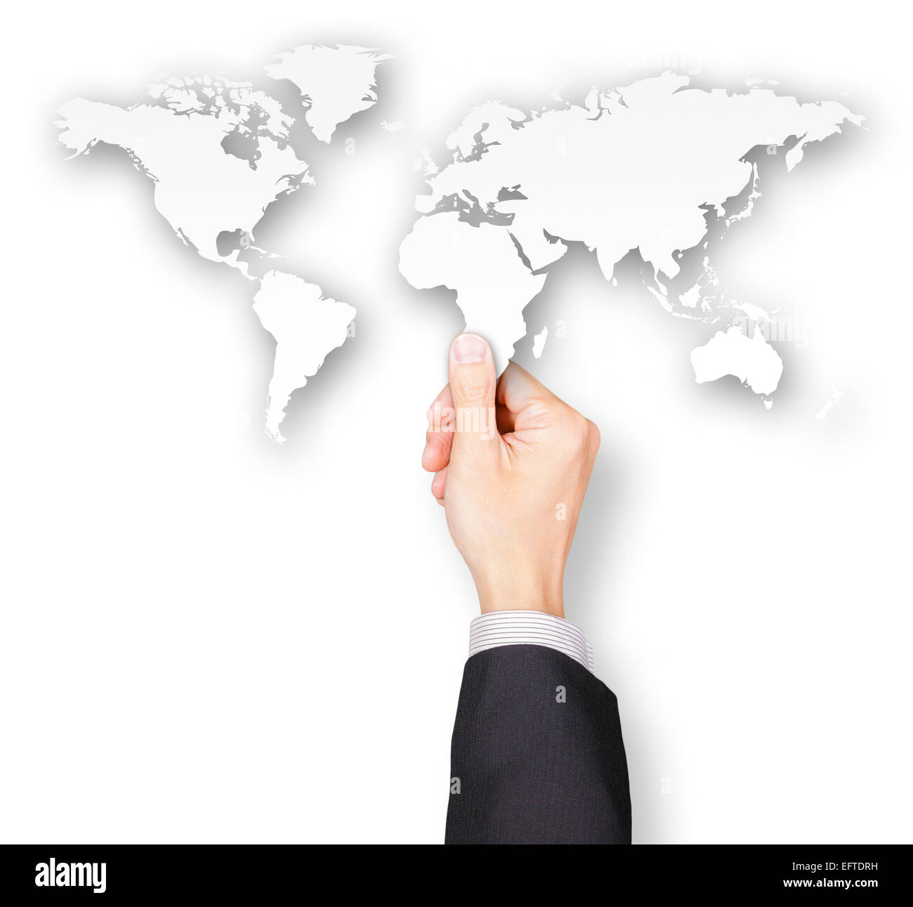 Hand of businessman holding world map paper - Stock Image