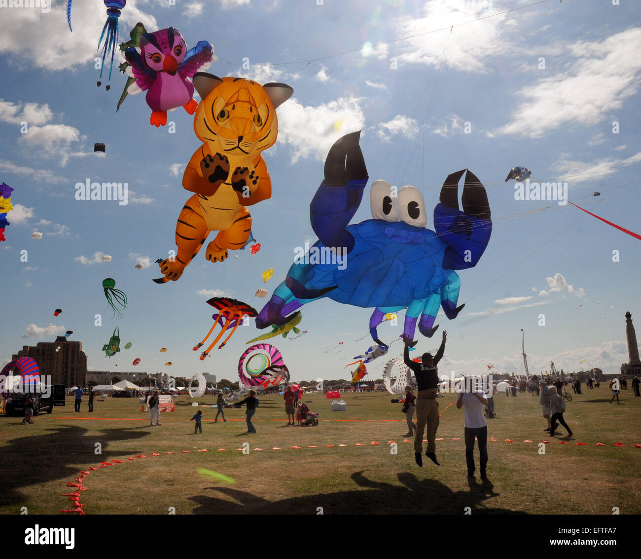 Kites of all shapes and sizes flying over the seafront at Southsea, Hants at the annual Kite Festival. Pic Mike Stock Photo