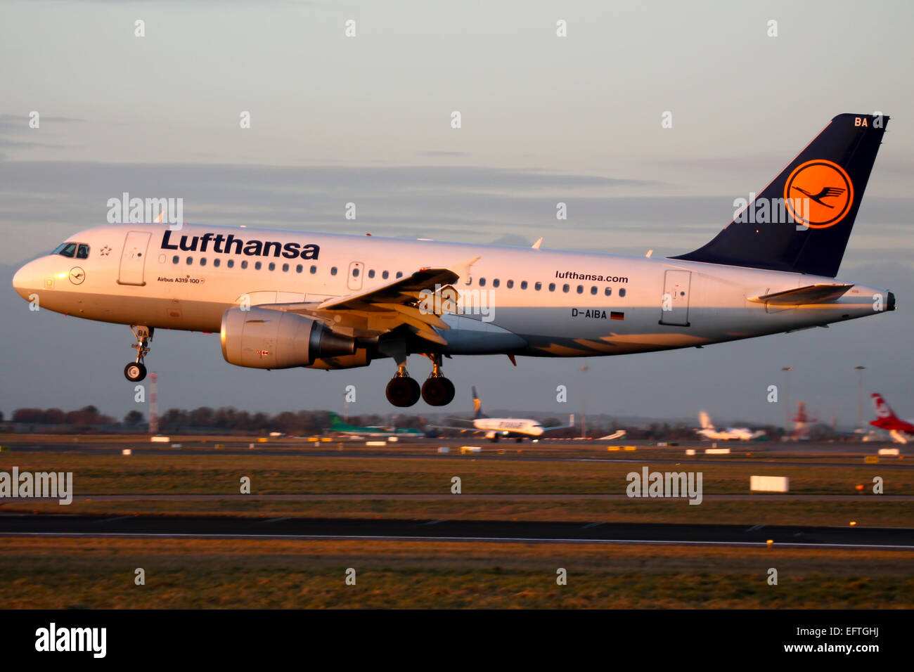 Lufthansa Airbus A319 approaches runway 28 at Dublin airport. - Stock Image