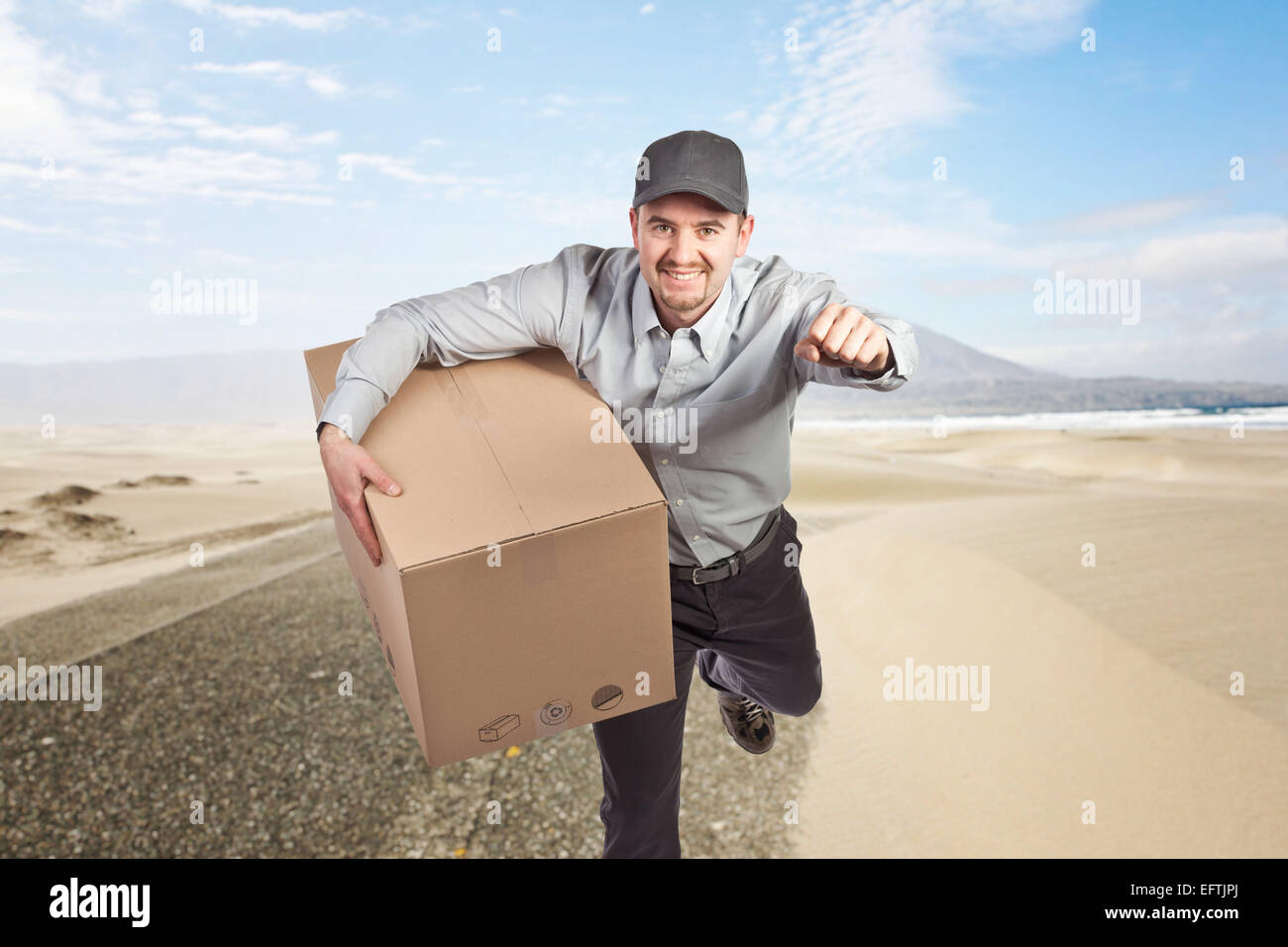 smiling delivery man and desert background stock photo 78602906 alamy