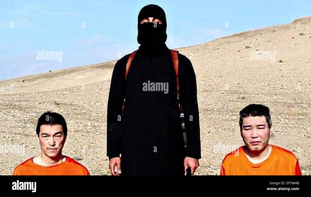 Islamic State of Iraq and the Levant fighter threatens to behead Japanese hostages Journalist Kenji Goto Jogo, left, Stock Photo
