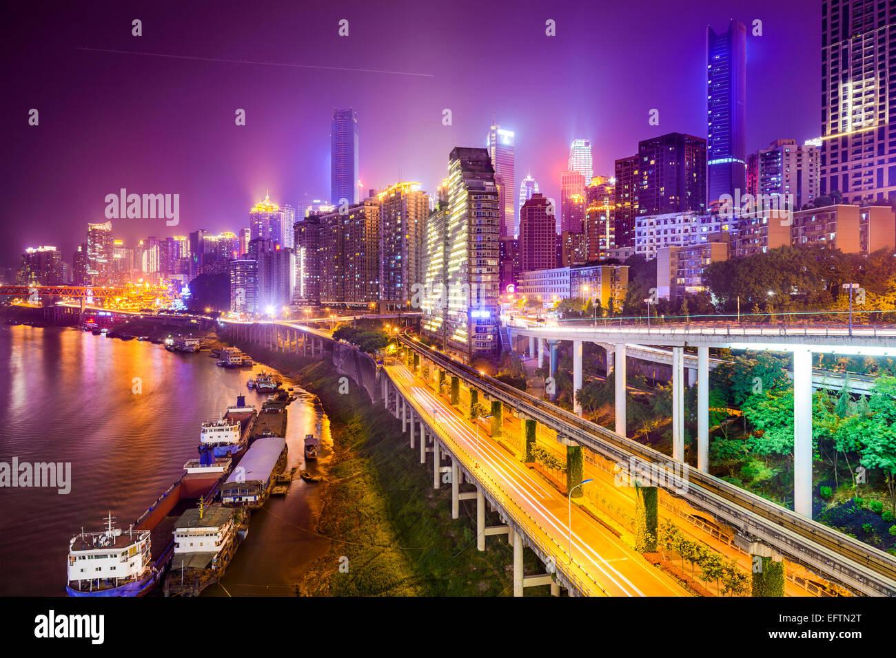Chongqing, China riverside cityscape at night. - Stock Image