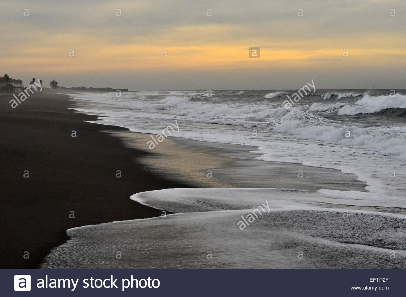 Rainy overcast winter morning beach Mediterranean coast Almeria Southern Spain Europe - Stock Image