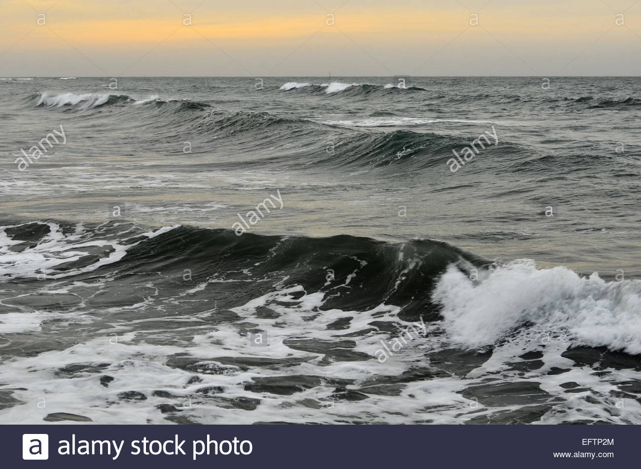 Grey waters waves windy overcast day Almeria Spain Europe - Stock Image