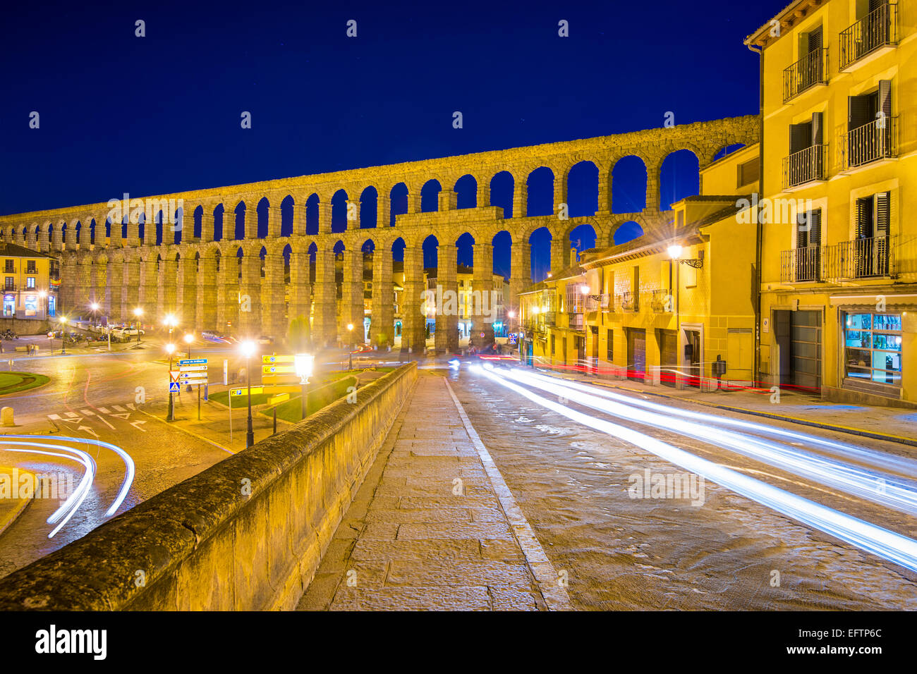 Segovia, Spain old town view at the ancient Roman aqueduct. Stock Photo