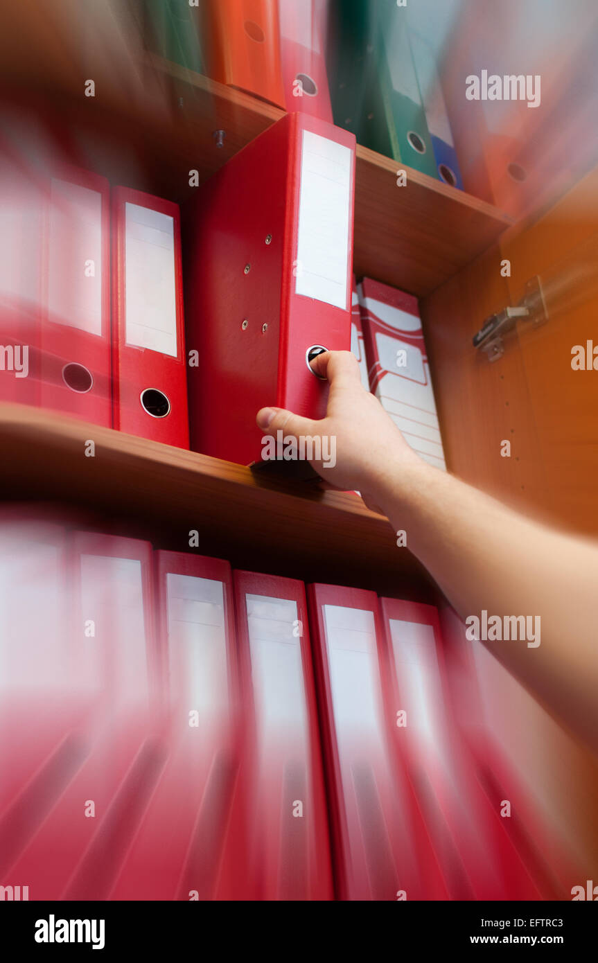 hand reaching for the briefcase of documents - zoom in - Stock Image