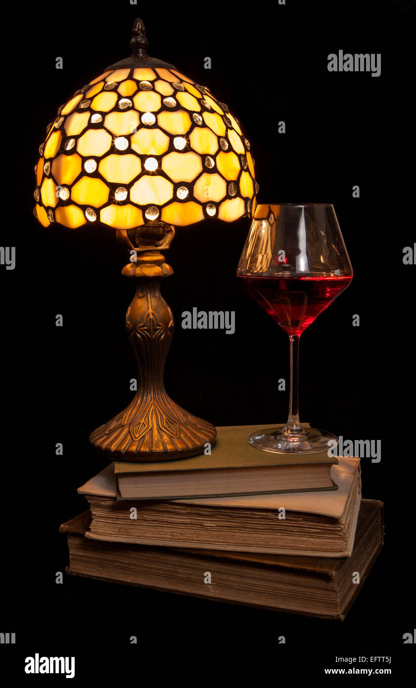 cosy evening read with red wine cutout - Stock Image