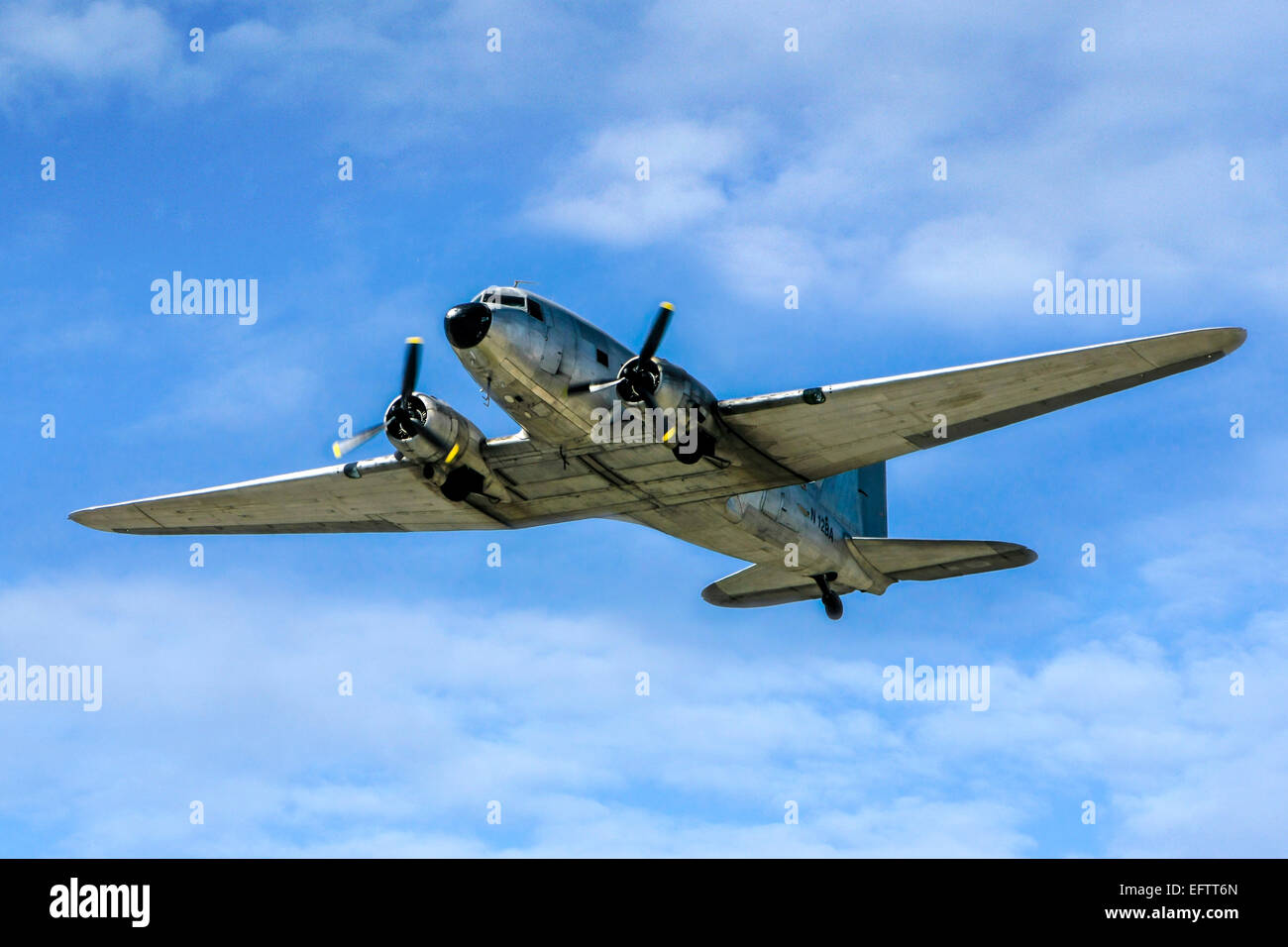 Douglas C-47A (DC3A) flying over Sarasota in Florida. Built in 1943 and now based at Punta Gorda FL Stock Photo