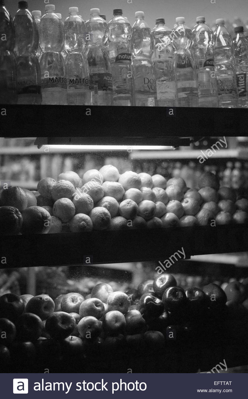 Prague Czech Republic - Nobody Shop Store Window Display Oranges And Plastic Bottles Filled With Drinking Water - Stock Image