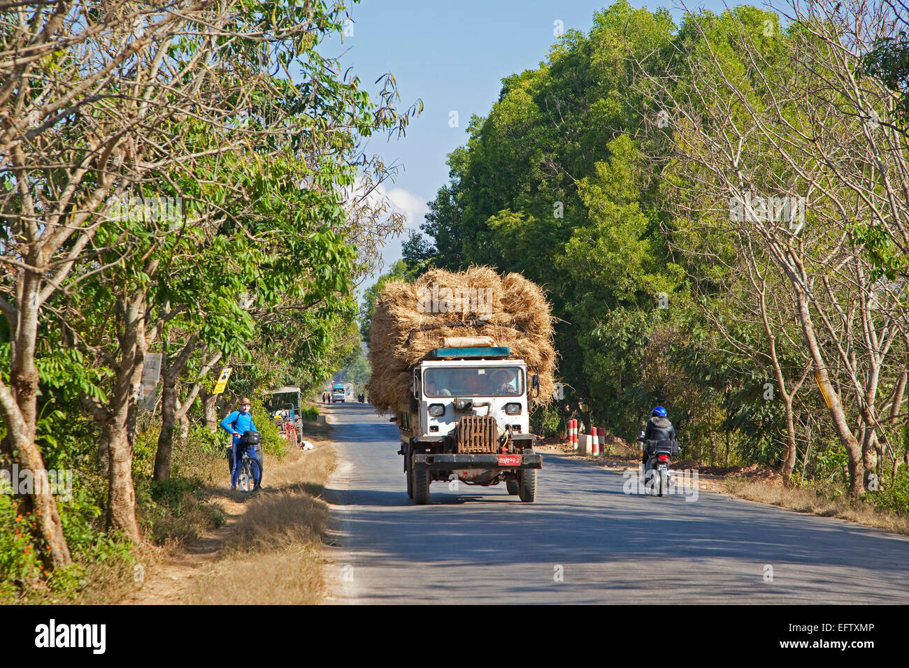 Heavily loaded truck transporting hay, Taunggyi District, Shan State, Myanmar / Burma - Stock Image
