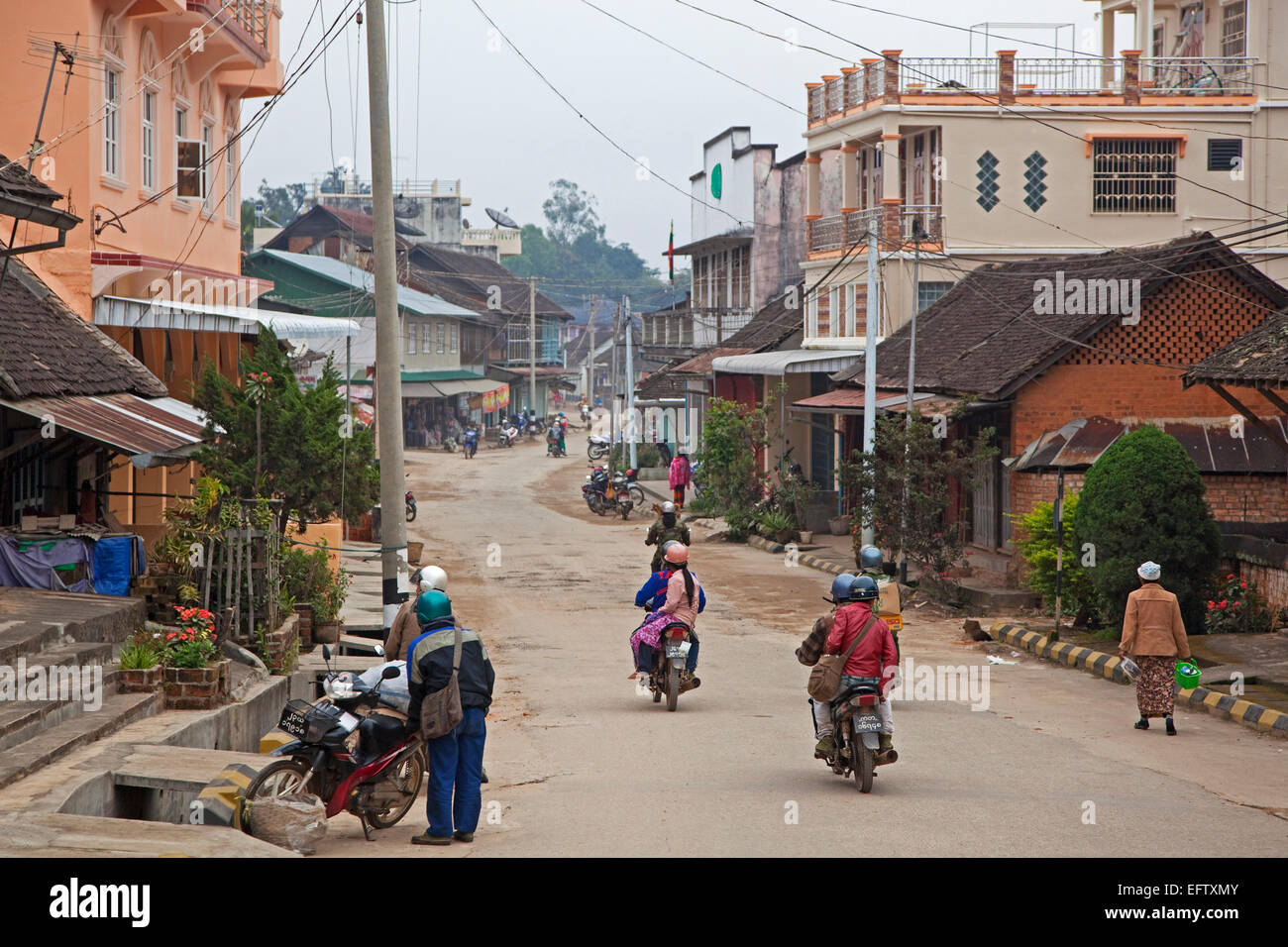 Motorcycles riding through the town Keng Tung / Kengtung, Shan State, Myanmar / Burma - Stock Image