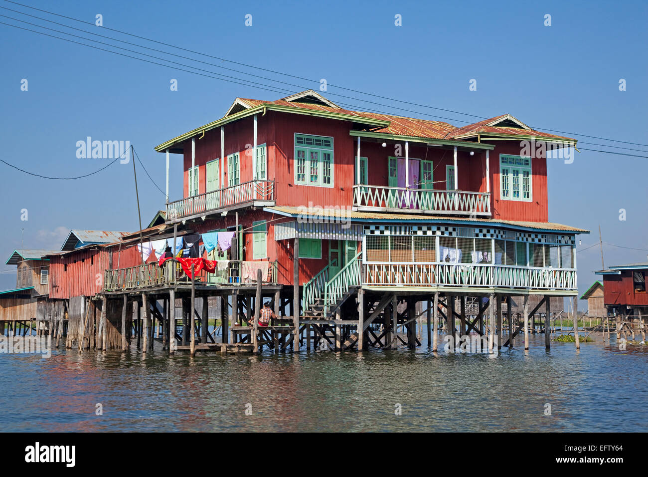 Traditional wooden houses on stilts in Inle Lake, Nyaungshwe, Shan State, Myanmar / Burma - Stock Image
