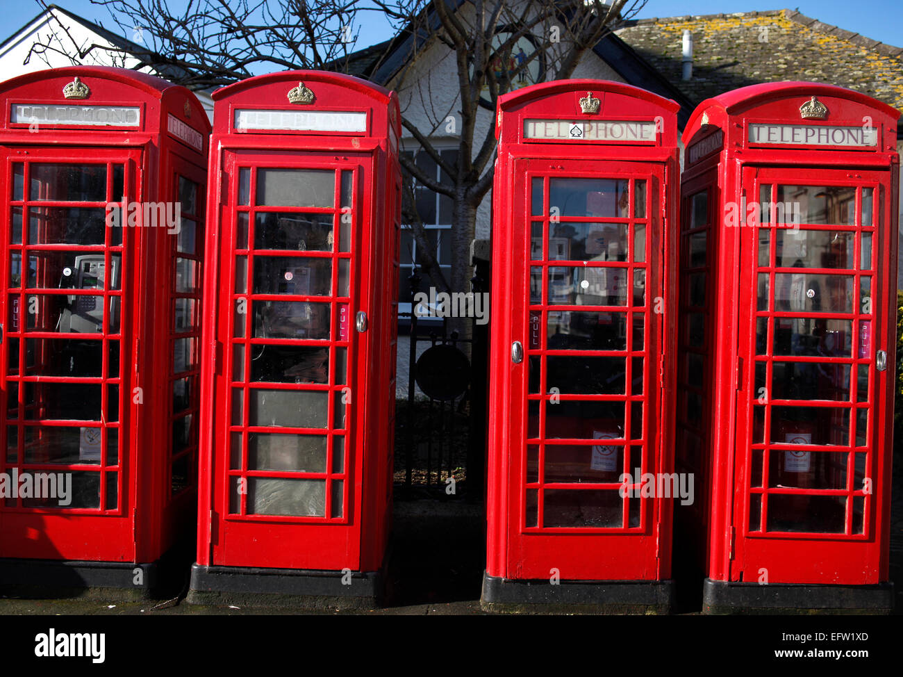 Traditional red telephone call boxes in Truro, Cornwall. - Stock Image