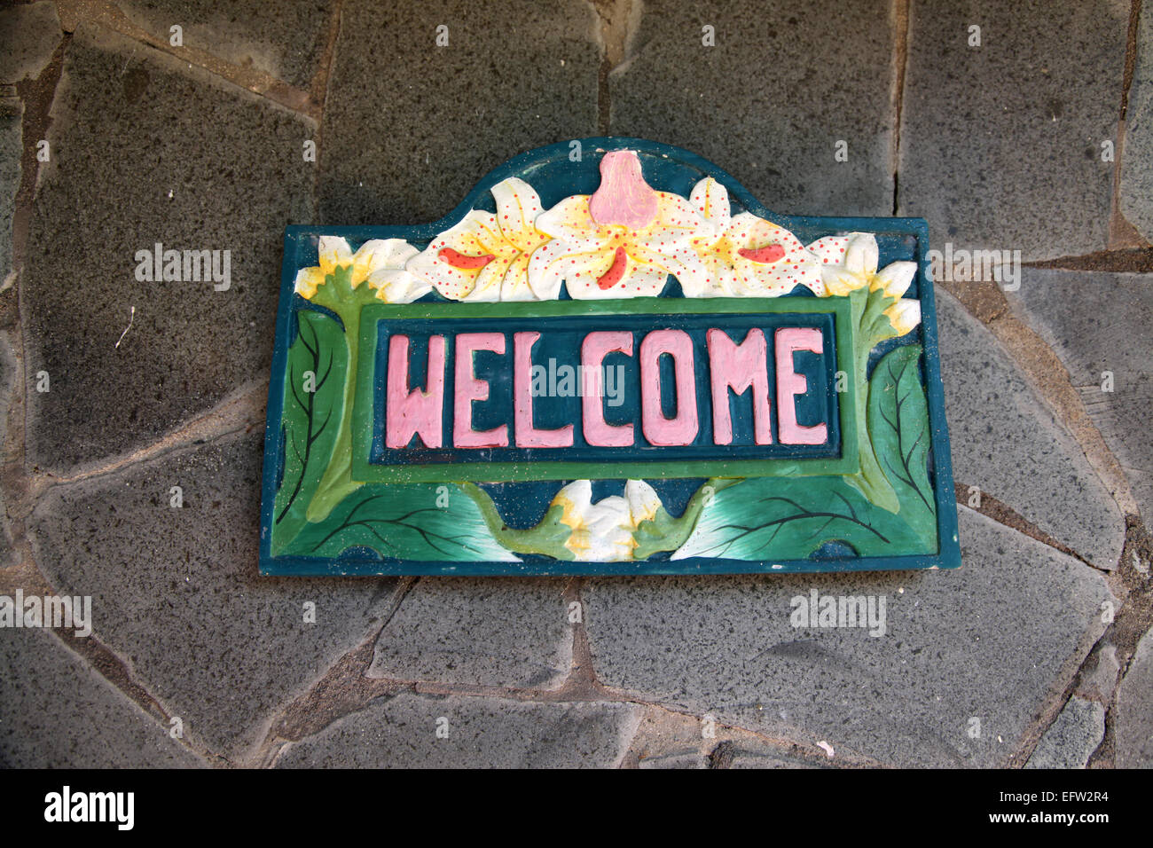 A flamboyant sign on a Caribbean Villa welcoming all guests - Stock Image