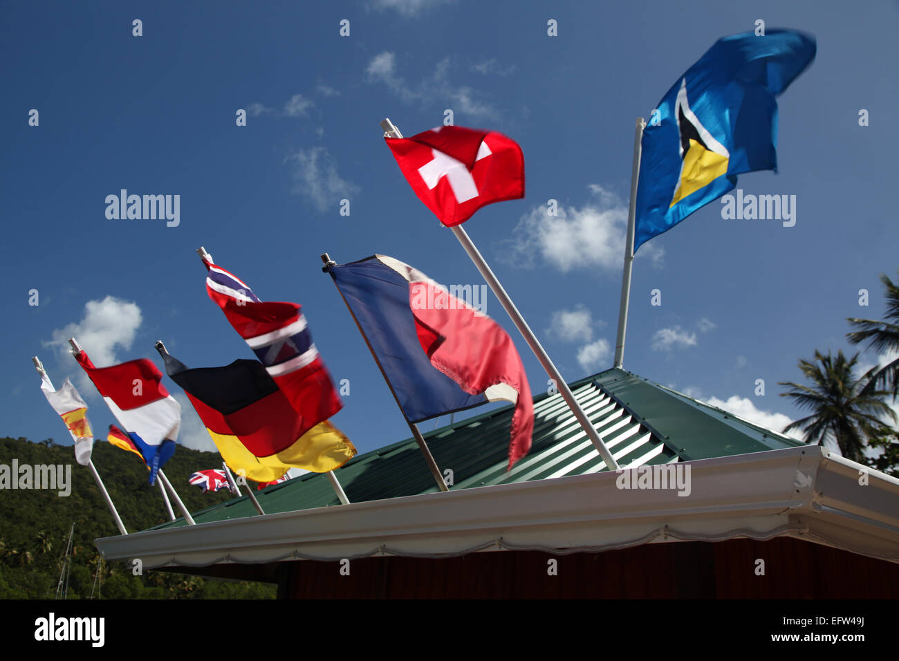 A sample of the flags around the world represented on the roof of a Bar in Marigot bay, St. Lucia - Stock Image
