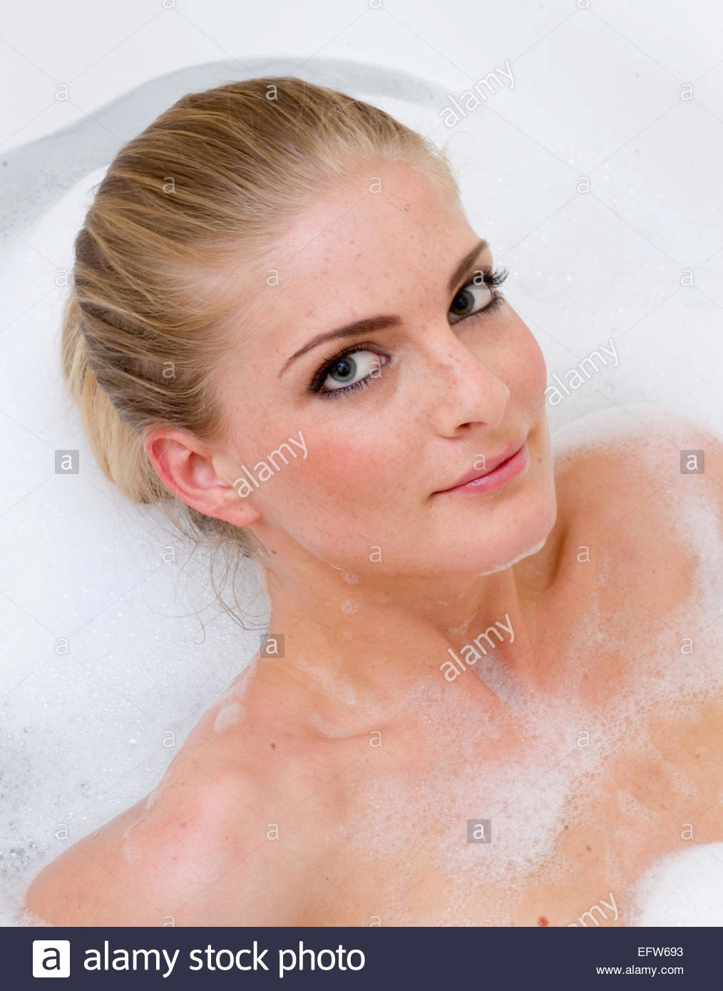Young face portrait alone adult attractive Smiling Face Woman Bathtub Shampoo Washing Hair Lifestyle Portrait Young Stock Photo