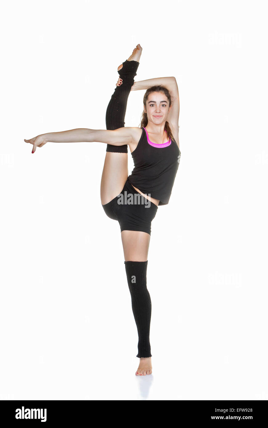 flexible teen ballet dancer stretching exercise - Stock Image