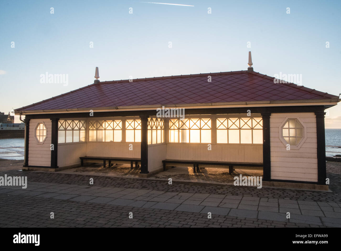 Rebuilt shelter along Marine Terrace,with views of beach, and Cardigan Bay at sunset, Aberystwyth, Ceredigion,Mid Stock Photo