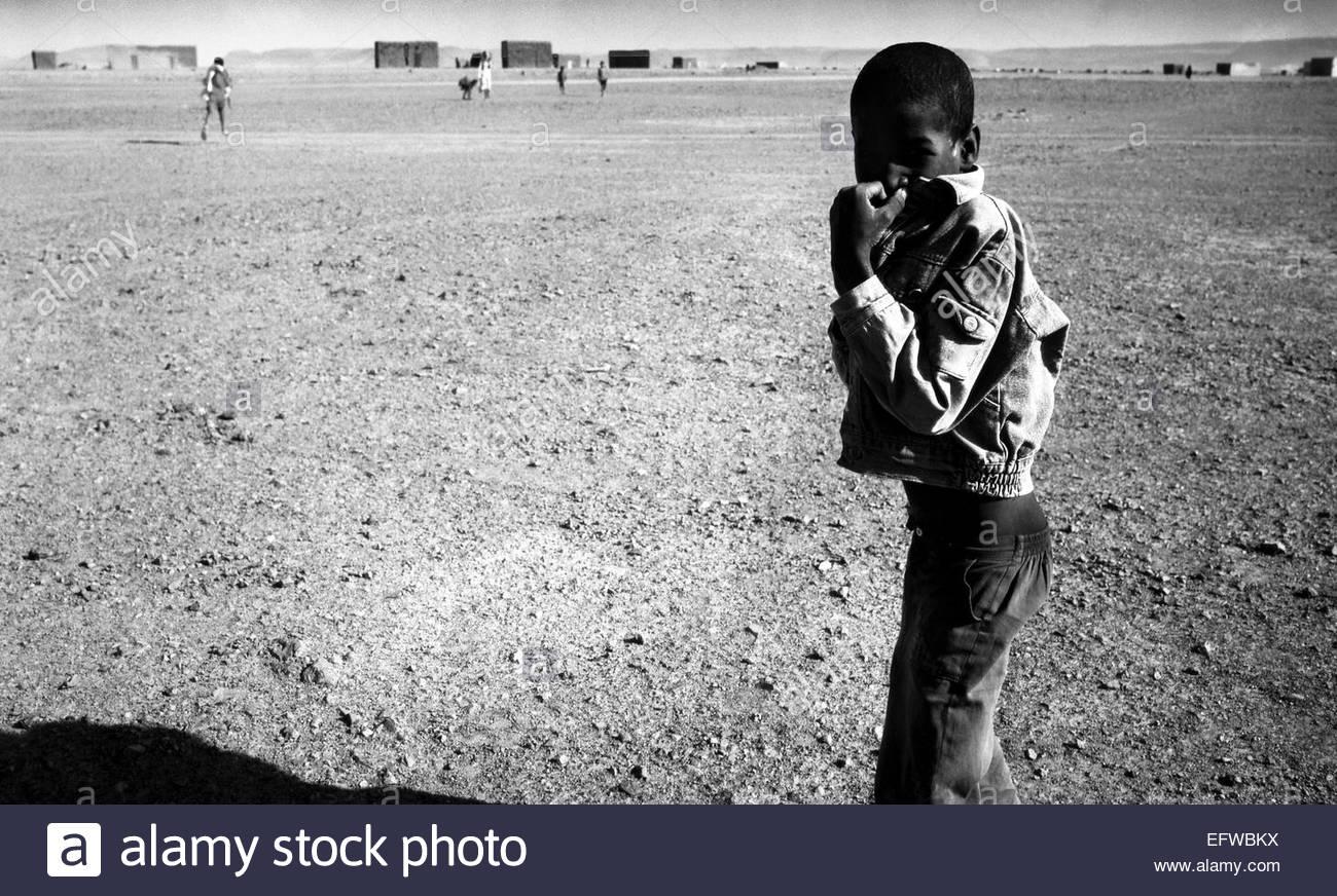 Arab Arabic Arabs Looking At Camera Posing Portrait Portraits Alone One Person Man Male Men Boy Boys Child Children - Stock Image