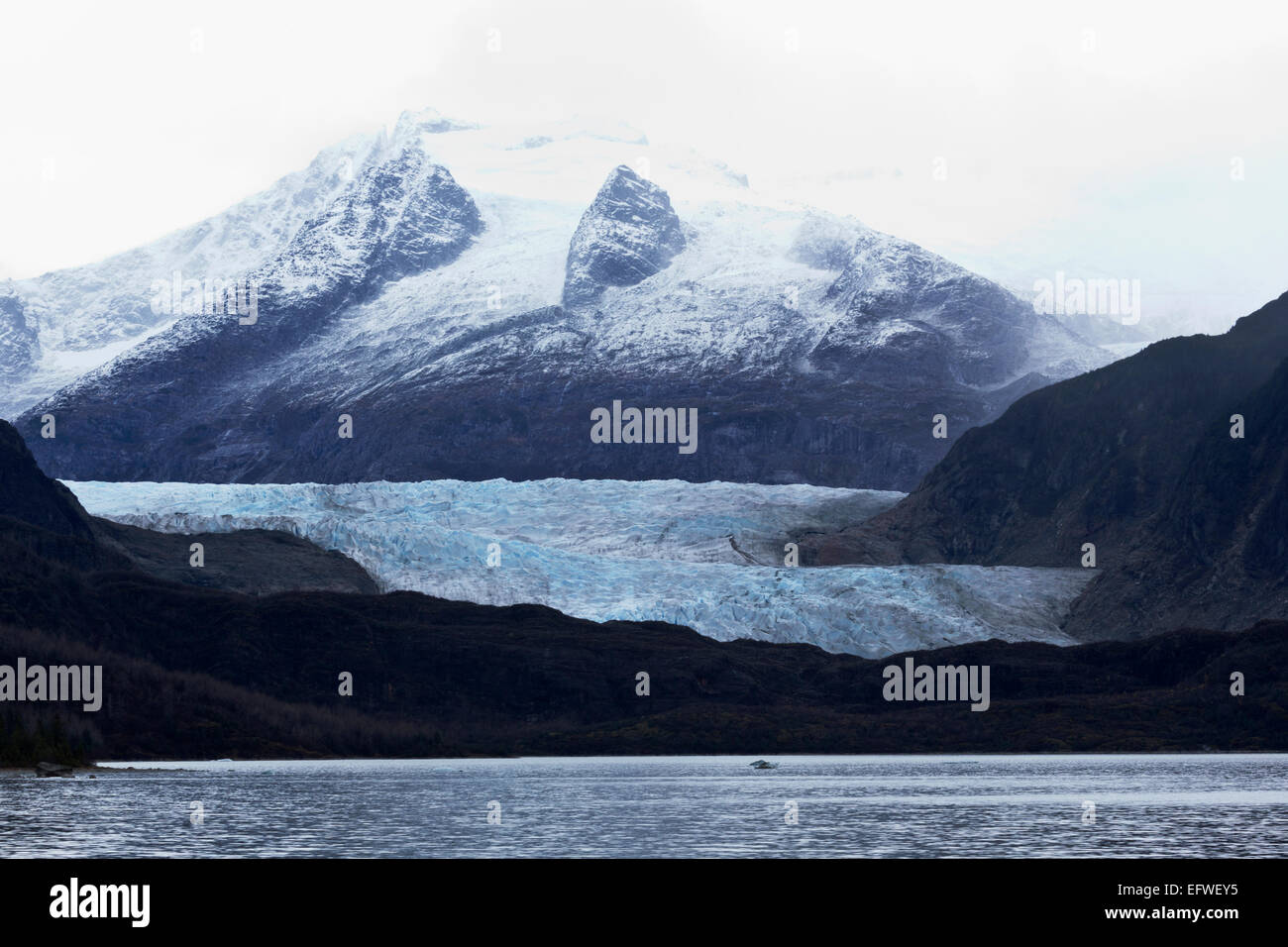 View across Mendenhall Hall Lake to glacier and icefields in Juneau, Alaska. Site is major tourist attraction. Stock Photo