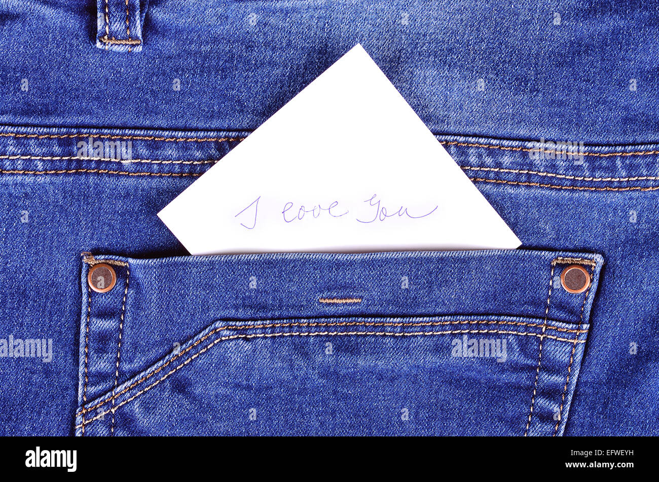 Sticker in back pocket blue jeans, detail - Stock Image