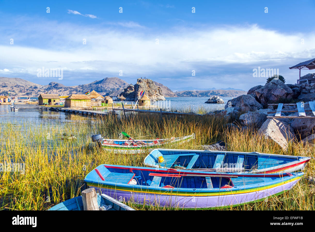 Colorful boats near floating islands on Lake Titicaca near Copacabana, Bolivia - Stock Image