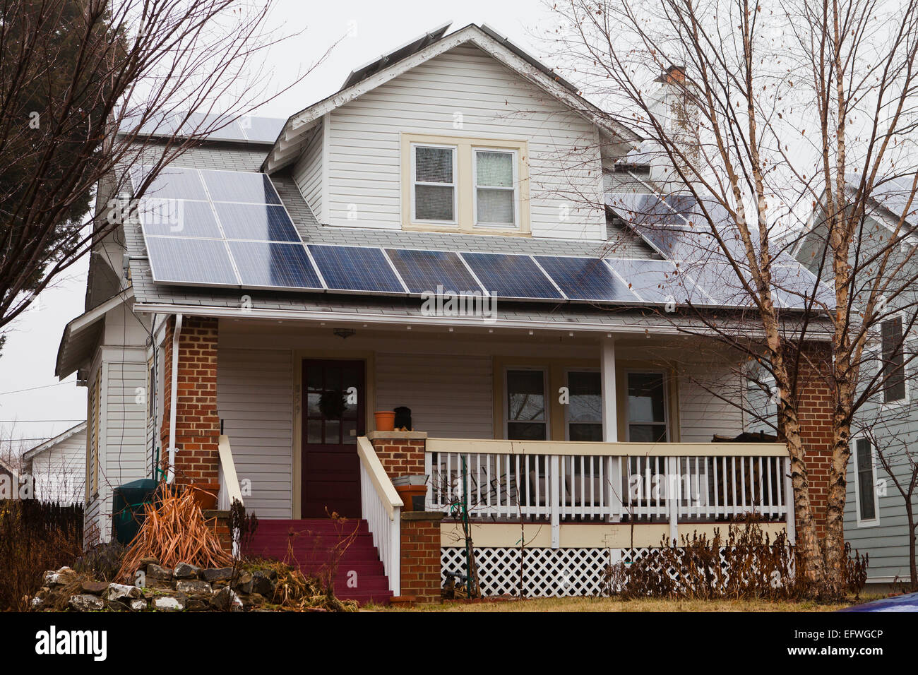 Solar panels on roof of small house - USA - Stock Image