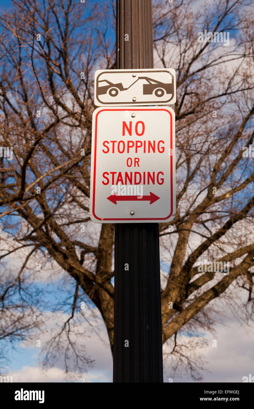 Tow Away zone No Parking or Stopping sign on pole - USA - Stock Image