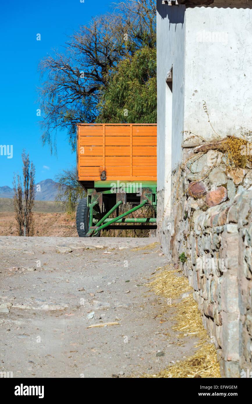 Vertical view of an orange and green wagon un rural Bolivia near Potosi - Stock Image