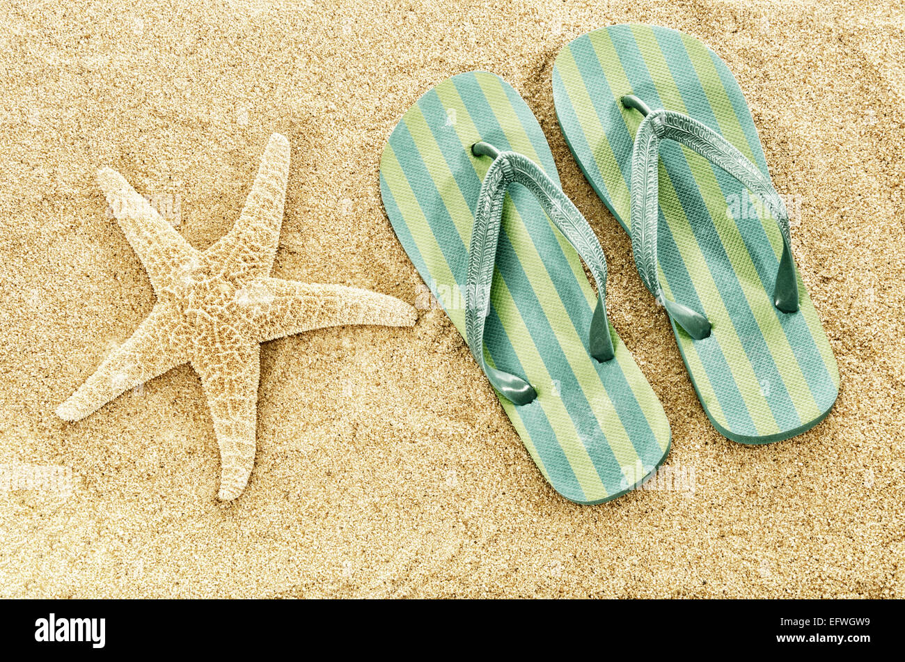 306d6961a4d49 Flip flops beach slippers on sandy beach starfish summer holiday vacation  concept copy space Digital filters faded retro vintage