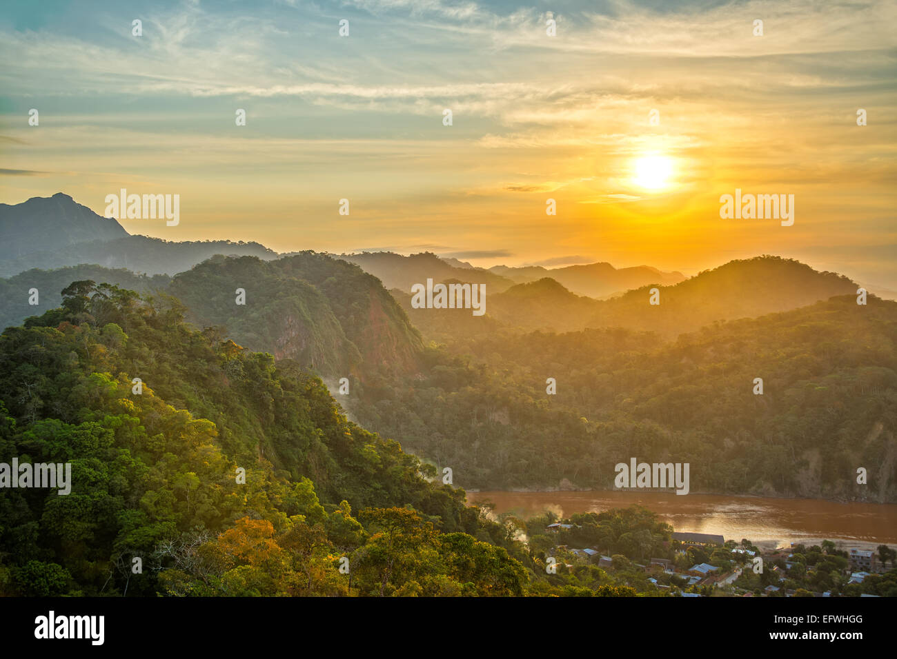 Sunset over lush green jungle covered hills with the Beni River visible in Rurrenabaque, Bolivia - Stock Image