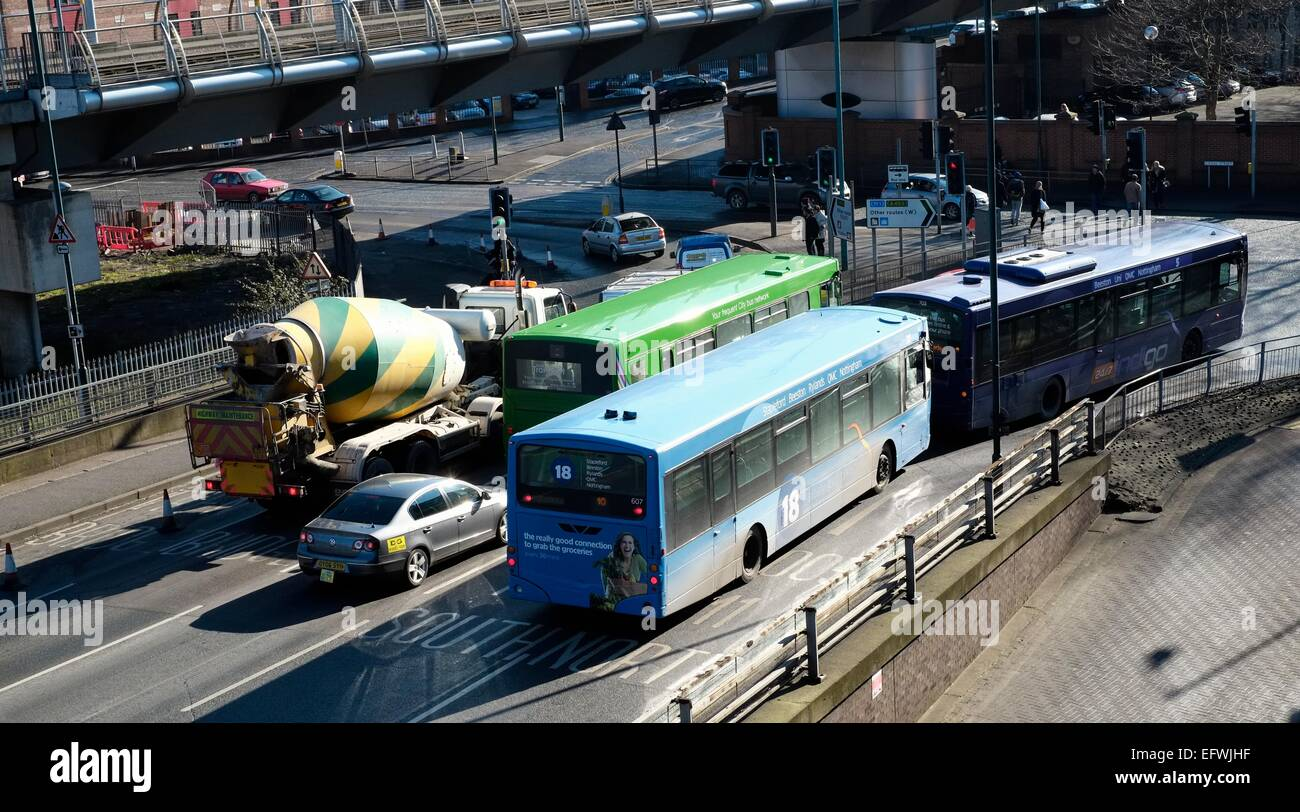 Buses and cars on a busy Middle Hill Nottingham England UK - Stock Image