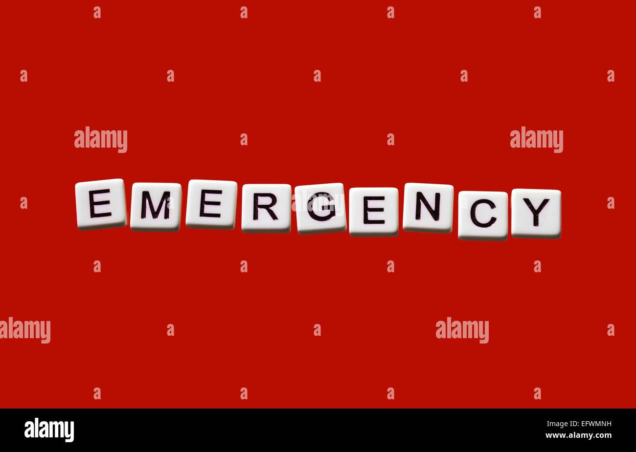emergency highlighted on white blocks - Stock Image