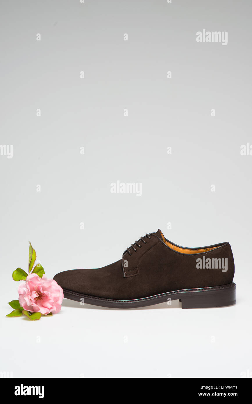 b599813225da Pair of Men s Shoes with flower isolated on white background - Stock Image