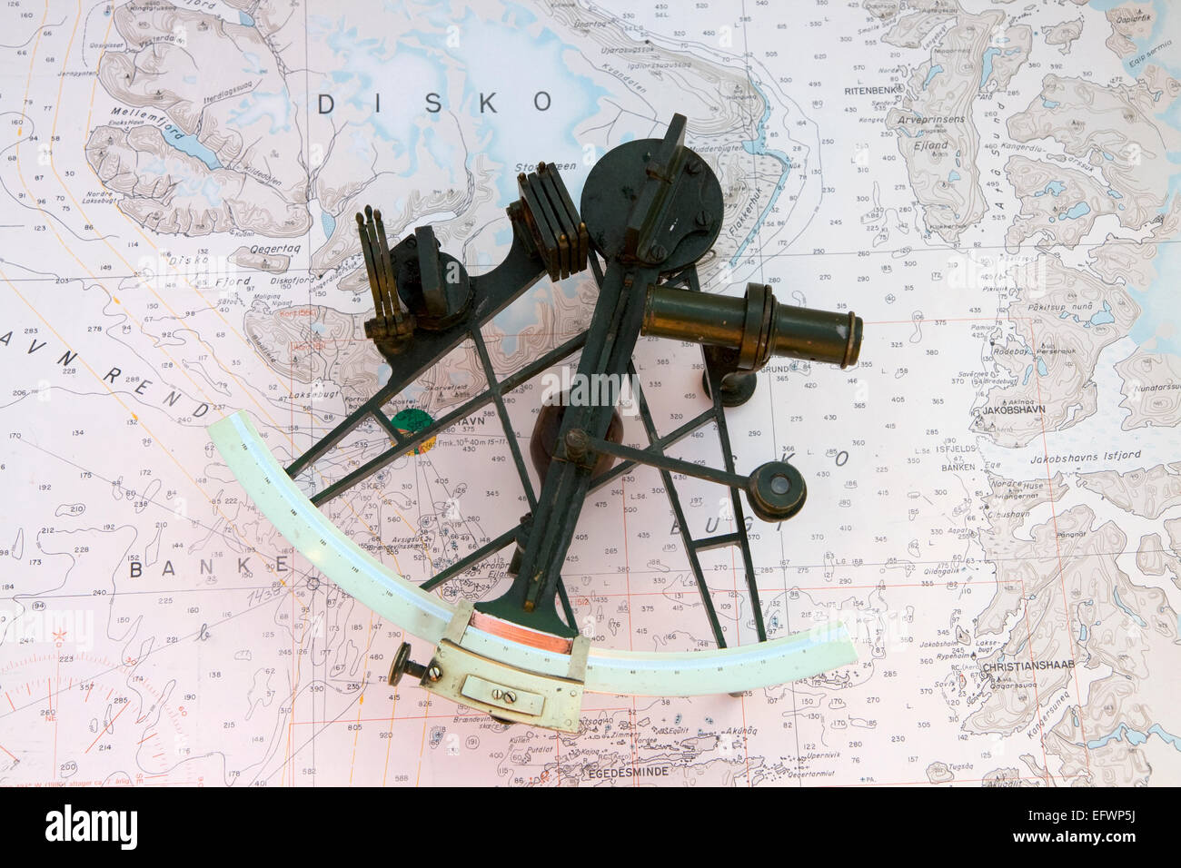 Old Sextant on a chart from the northern part of Greenland - Stock Image