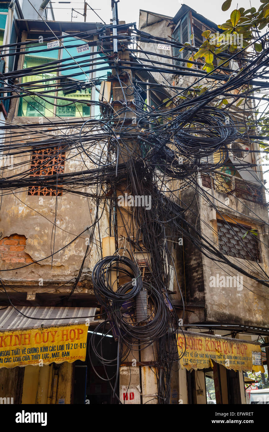 Electric pole in the old quarter, Hanoi, Vietnam. - Stock Image