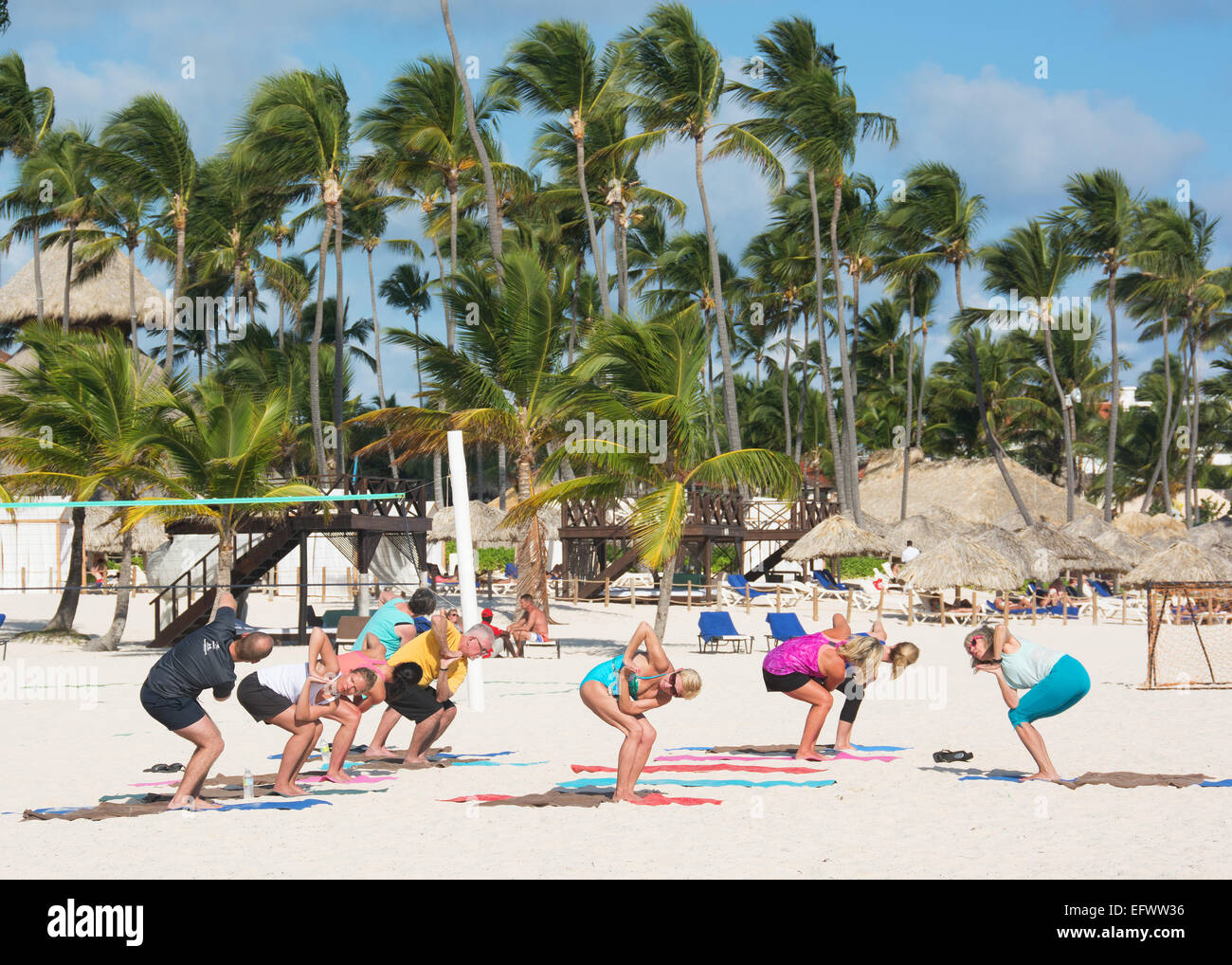 DOMINICAN REPUBLIC. Holidaymakers doing keep-fit exercises on Punta Cana beach. 2015. - Stock Image