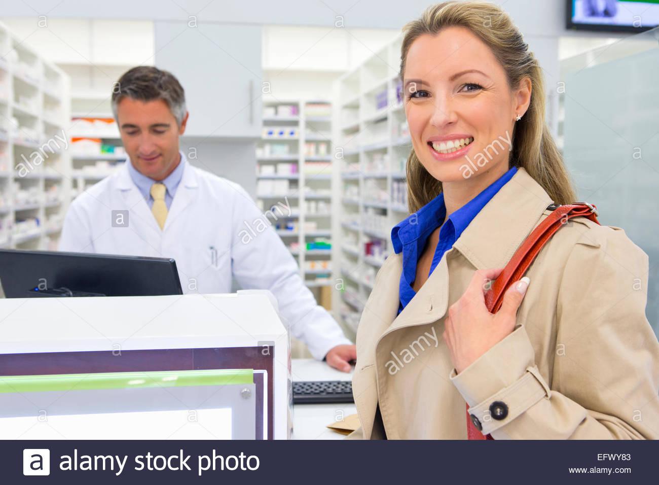 Female customer smiling at camera in pharmacy Stock Photo