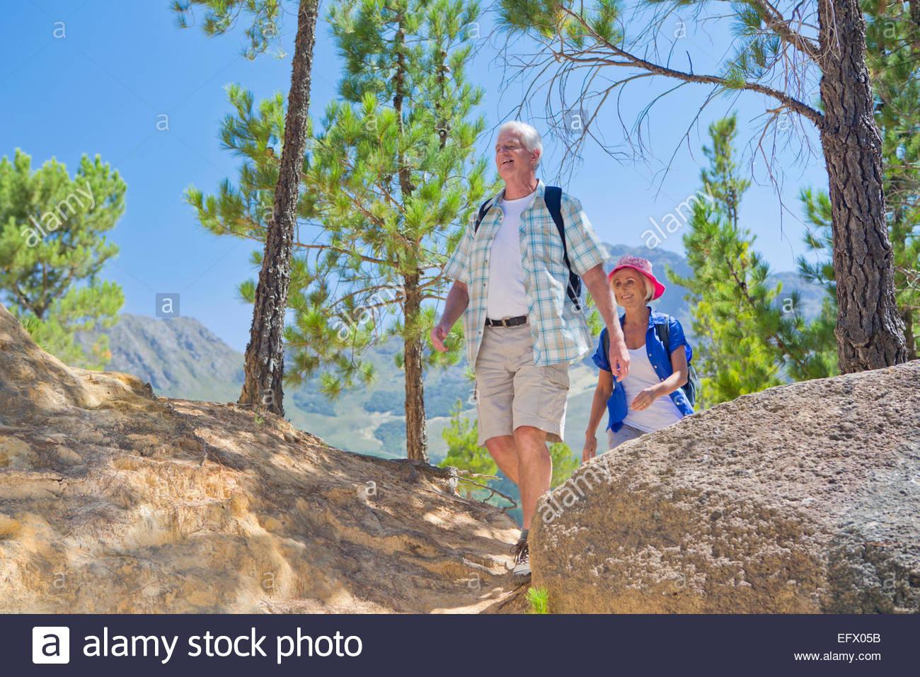 Senior couple hiking on mountain path - Stock Image