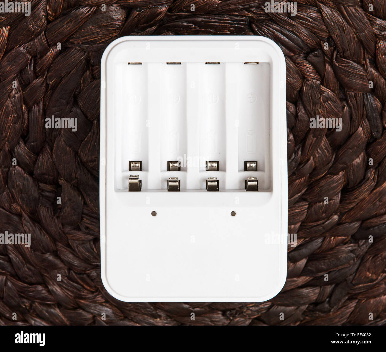 White battery charger. Power source. Stock Photo