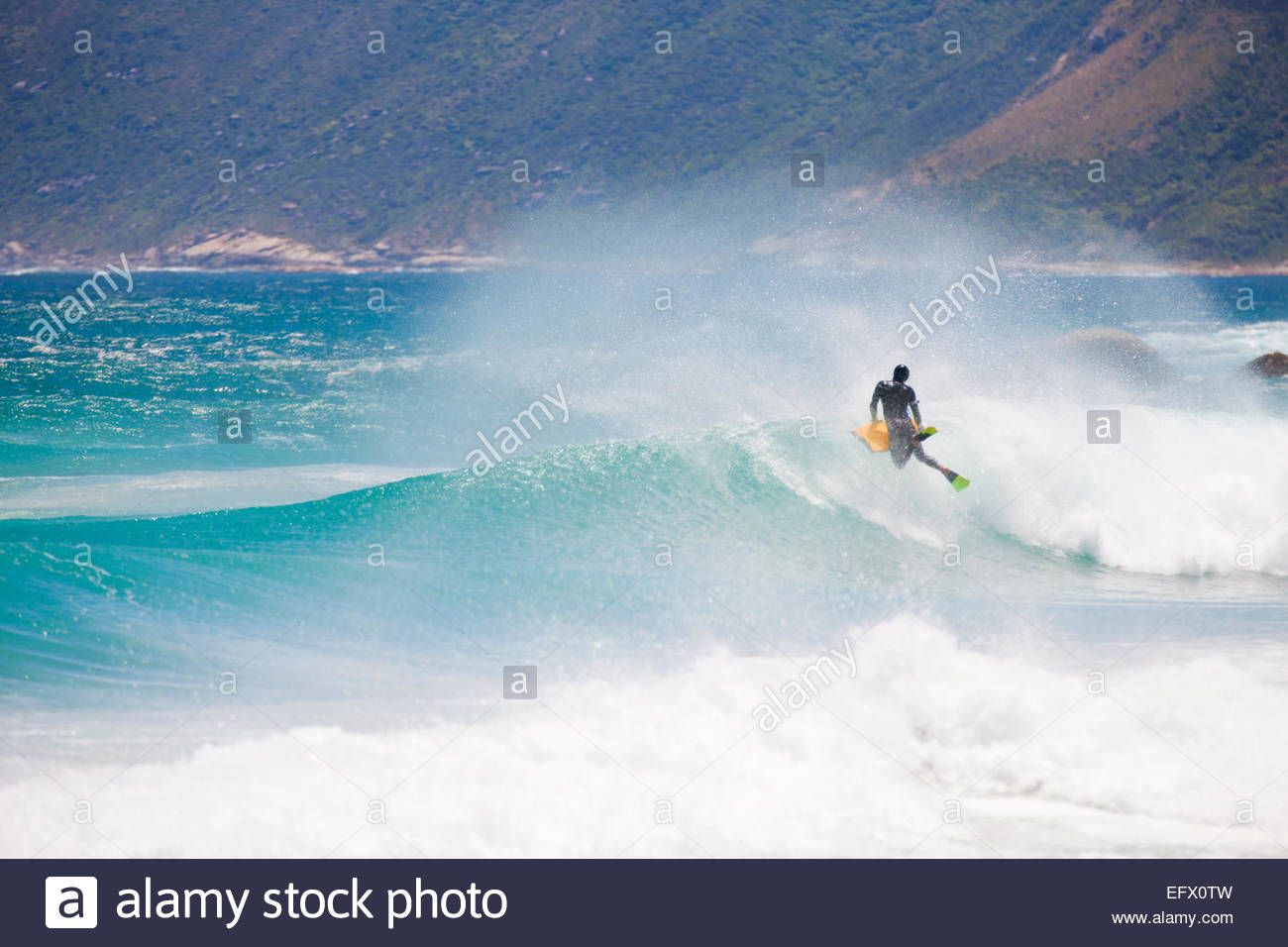 Body boarder riding wave - Stock Image