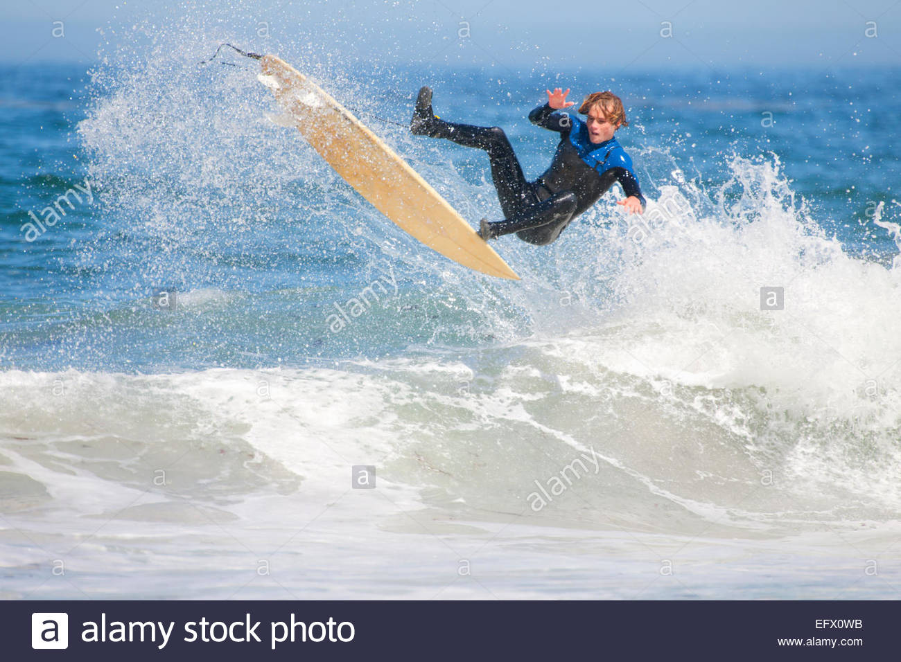 Surfer, mid air, falling off surfboard - Stock Image