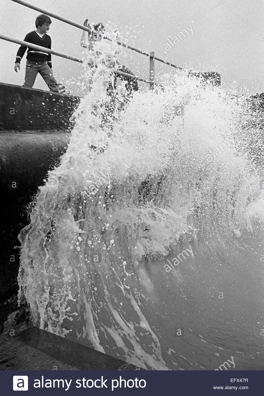 Waves Crashing Kent Seaside Child Boy Sea Seawater Rough Wild Kids Playing United Kingdom Great Britain British - Stock Image