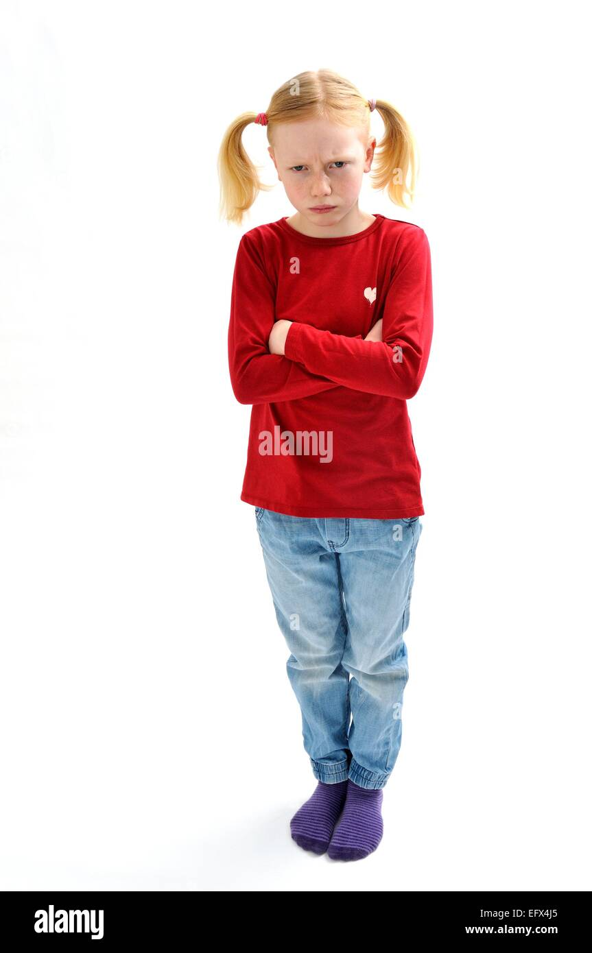 Young girl with pig tails angry bad tempered - Stock Image