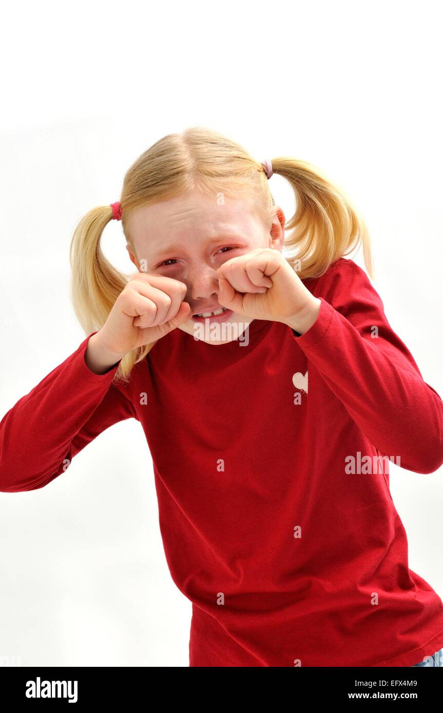 Young girl crying - Stock Image
