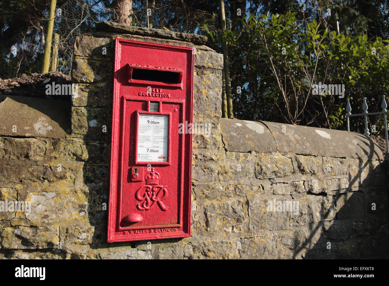 British wall embedded red post box - Stock Image