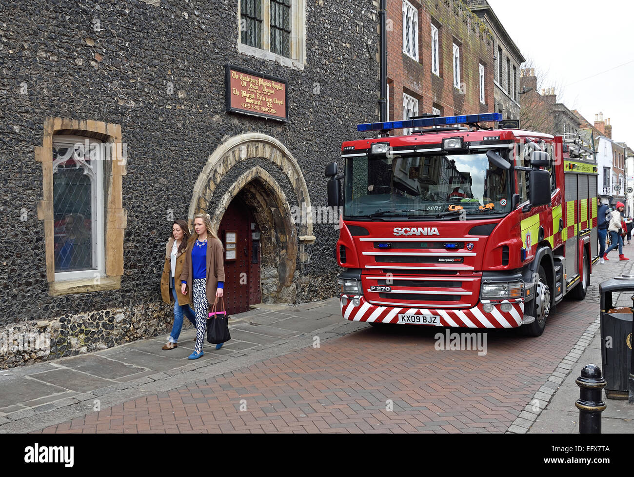 Scania P270 Fire Engine passing th entrance to Canterbury Pilgrim´s Hospital of St Thomas, or Eastbridge Hospital, - Stock Image